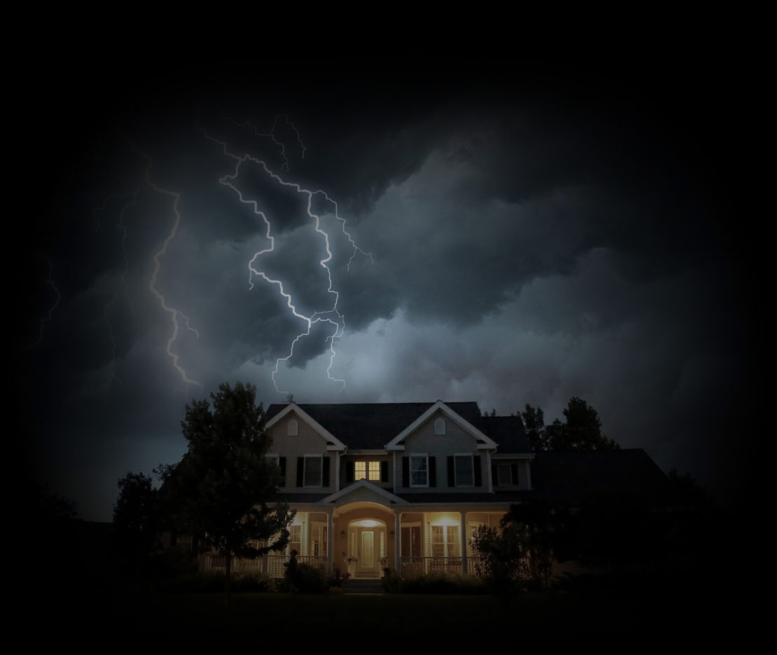 View of contemporary home being struck by lightning, but house lights remain on