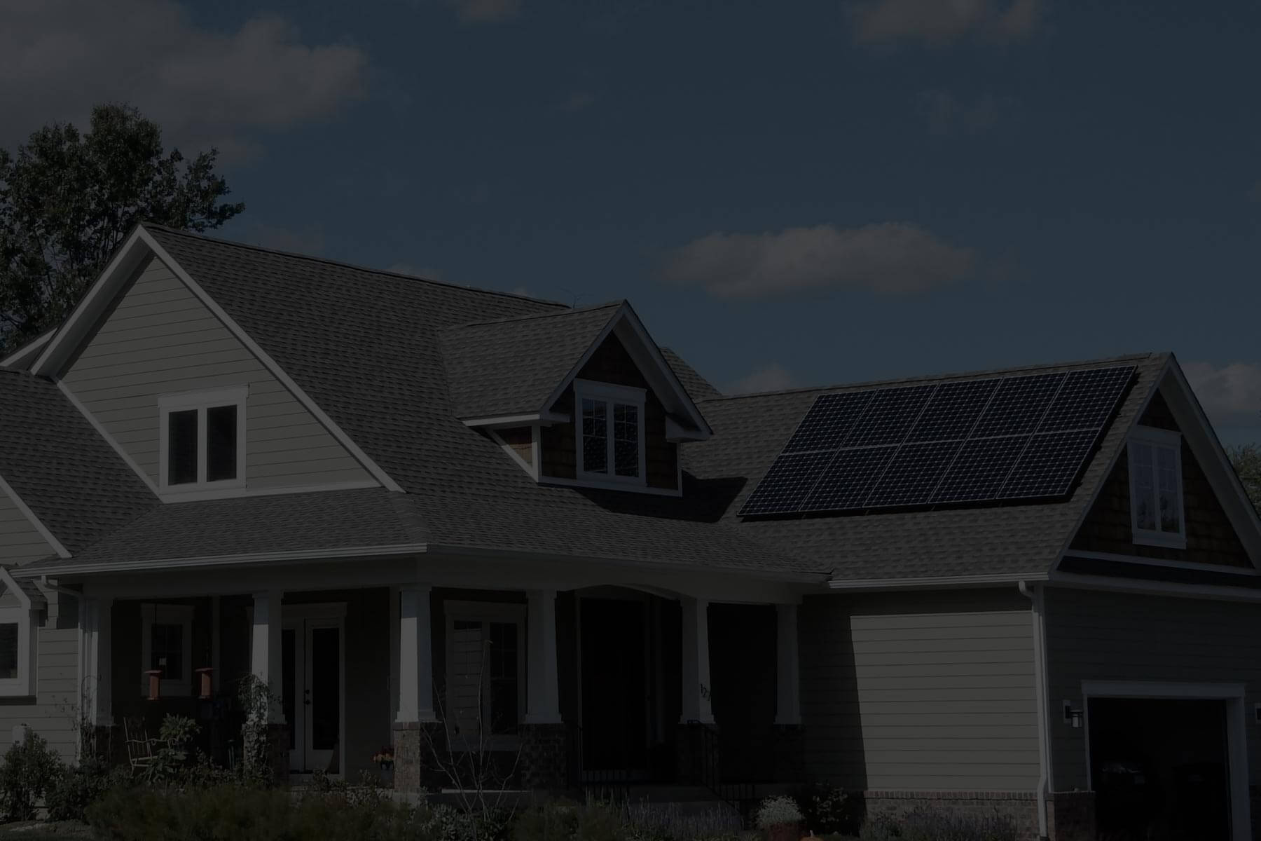 Outdoor view of contemporary home with solar panels with PowerPod system inside garage