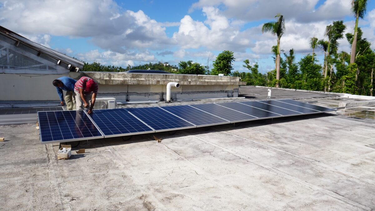 Installing donated solar panels on roof of Puerto Rican Children's Home